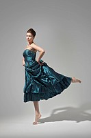 beautiful woman in dress dancing
