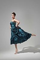 beautiful woman in dress dancing