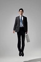 Businessman jumping in Studio