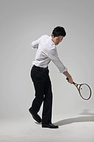 Businessman playing tennis
