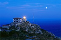 Lighthouse and moon, Cabo Finisterre, Province La Coruna, Galicia, Spain