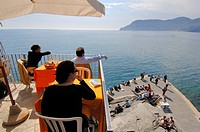 People at the terrace of a cafe, Vernazza, Cinque terre, Liguria, Italy, Europe