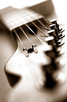 close up of head of guitar