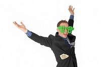 Happy man throwing hands in the air, with dollar sign glasses