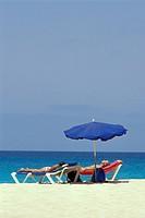 Women on sunloungers on the beach of Santa Maria, Sal, Cape Verde, Africa