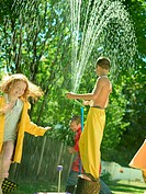 Kids playing in sprinkler