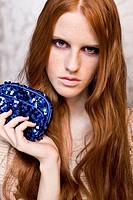beautiful woman with shiny handbag