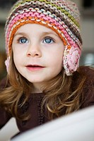 Young girl in knitted hat