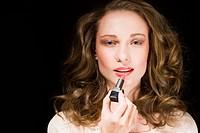 beauty woman applying pink lipstick