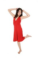 Beautiful Asain woman in a red sundress poing on a white background