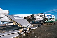 Aircraft dismantling. Passenger plane being disassembled. At the end of their life aeroplanes are dismantled and recycled. Various retrievable parts s...