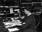 Florence Rena Sabin 1871_1953, US medical researcher, working at her desk at Johns Hopkins University, USA. Sabin studied and taught anatomy and histo...