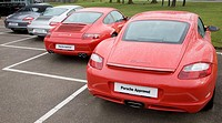 Porsche cars on dealership forecourt