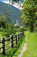 Riverside path to the church of San Pancrazio beside the Mediaeval walled town of Glurns, Glorenza  Val Venosta, Italian Alps