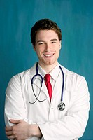 happy young male doctor man smile handsome portrait green background