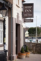 pub front at marina with free trade sign Ship Inn and sign offering showers for yachties