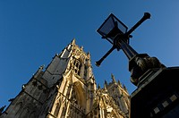 England, North Yorkshire, York, Black lampost and gothic detailing on York Minster Cathedral in North Yorkshire