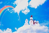 A family of snowmen on a cloud under a rainbow