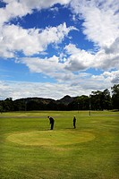 Scotland, City of Edinburgh, Edinburgh, A man putting at the golf club in Brunstfield Links