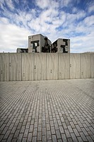Scotland, City of Edinburgh, Edinburgh, The top of the Scottish Parliament building from behind a wall