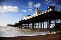 England, East Sussex, Brighton, A view from the beach up to Brighton Pier