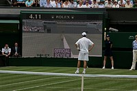 England, London, Wimbledon, A player watches the official review after a call is challenged during a match at the Wimbledon Tennis Championships 2008.