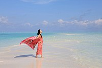 Woman enjoying the breeze at the beach, Maldive Islands