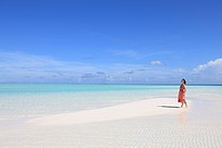 Woman at white sand beach, Maldive Islands