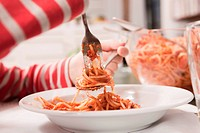 Germany, Cologne, Child eating spaghetti, close_up