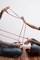 Two men stretching rope (thumbnail)