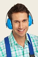 Man wearing ear muff, smiling, close_up, portrait