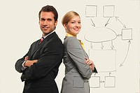 Businessmen and women back to back, smiling, portrait