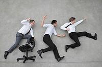 Three businessmen cheering, elevated view
