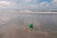 Germany, Schleswig Holstein, Amrum, Message in a bottle on the beach