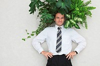 Businessman with Foliage Plants, hands on hips, smiling, portrait, elevated view