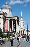 England, London, Trafalgar Square, Tourists passing the National Gallery in Trafalgar Square.