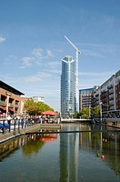 England, Hampshire, Portsmouth, A view of Gunwharf Quays showing a crane next to the Number One Tower.
