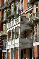England, London, Kensington, Ornate red brick apartment building at Campden Hill Court.