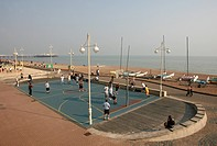 England, East Sussex, Brighton, Overlooking a game of basketball taking place on Brighton seafront.