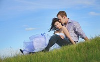 edmonton, alberta, canada, a couple sitting on the grass together