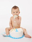edmonton, alberta, canada, a baby eating a birthday cake with his hands