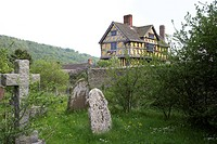 England, Shropshire, Stokesay, View across the graveyard to Stokesay Castle gatehouse in Shropshire.
