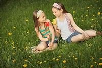 edmonton, alberta, canada, two girls holding tulips