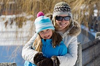 Mother and daughter outdoors in winter