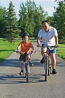 Father and son at the park with bicycles