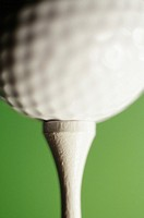 Golf ball on tee, close-up
