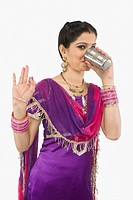 Woman drinking lassi and gesturing