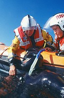 RNLI Royal National Lifeboat Institution practising diver rescue  The RNLI is a charity and relies on donations to maintain the boats and service  All...