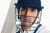 Portrait of a cricket batsman holding a bat