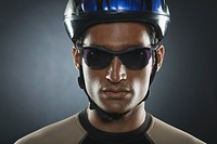 Man wearing a cycling helmet and sunglasses